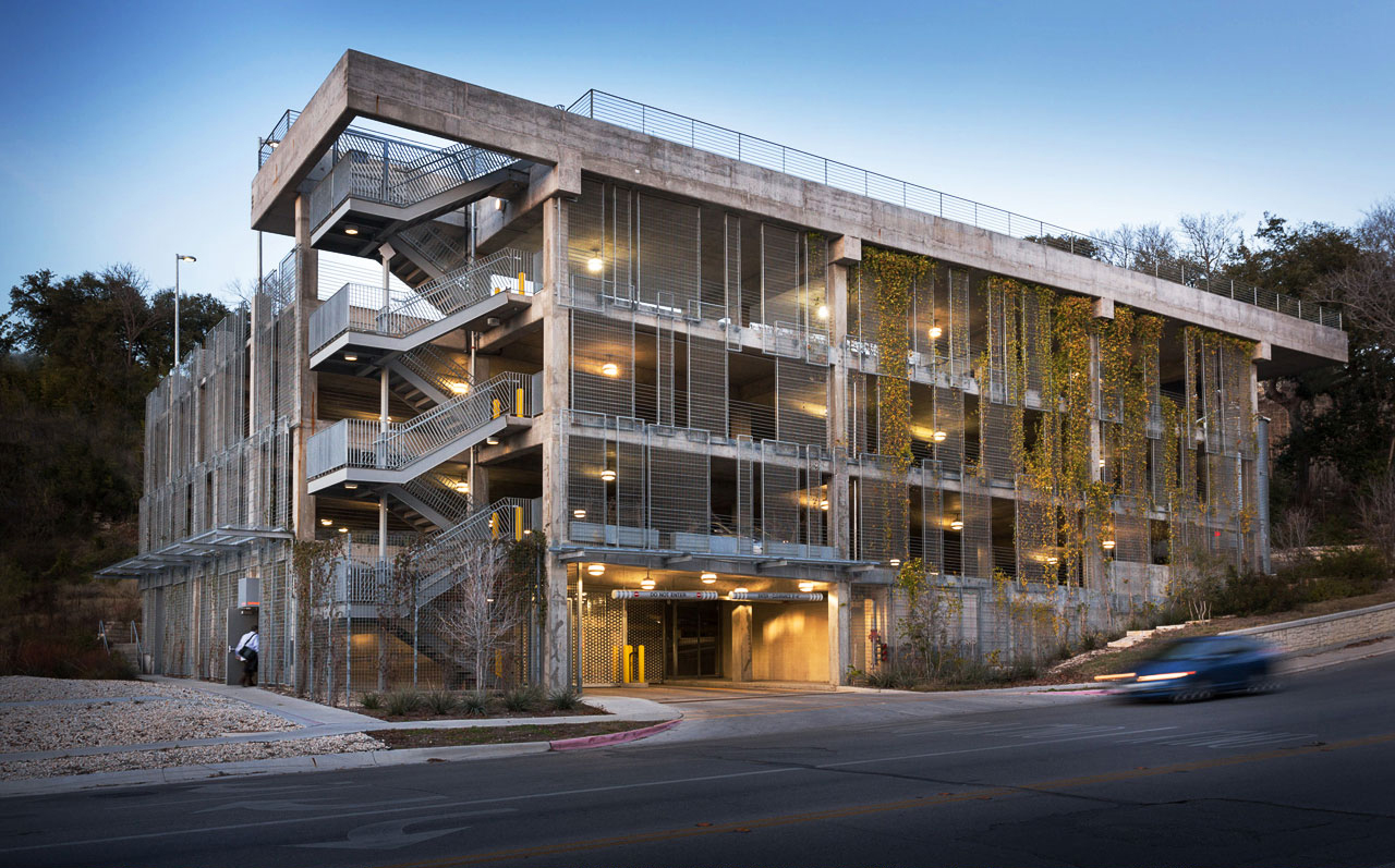 The Think Tank Parking Structure - Austin, Texas - <br>Living Screen® panels of varying sizes transform this concrete parking structure into a verdant wall befitting the neighboring urban green space.
