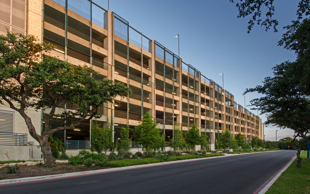University of Texas – San Antonio – Parking Structure - <br>Massive Living Screen® panels partially cover two facades of a six story structure, allowing vine growth to eventually extend from grade to beyond the top level.