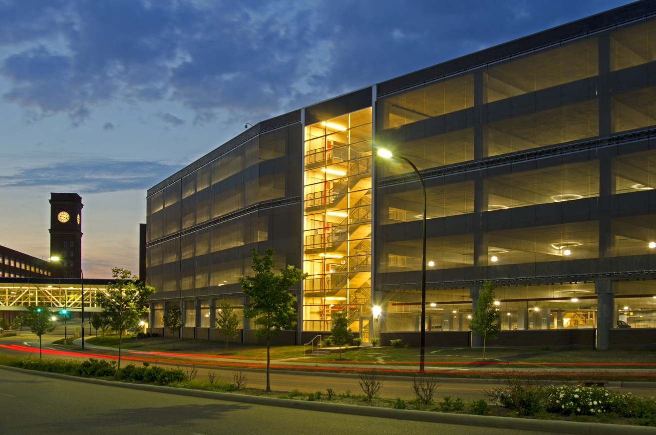 Goodyear – Innovation Way Parking Facility - Akron, Ohio - <br>Stainless steel woven wire tension screens clad the western facade of this six story parking structure and wrap it entirely at ground level for security.